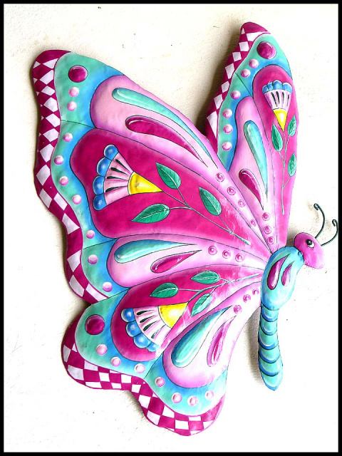 Painted metal butterfly wall art.
