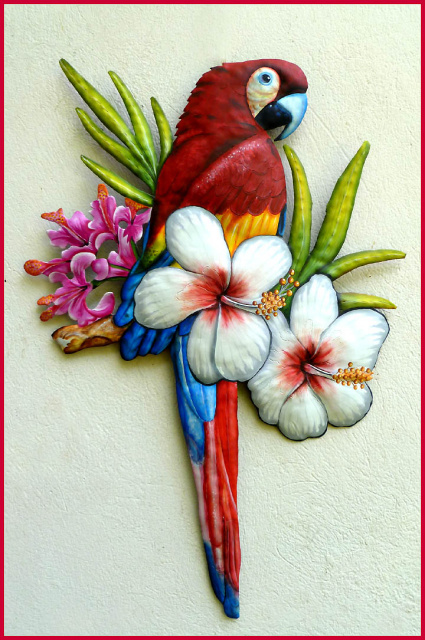 hand painted metal parrot wall hangiung. Hand cut from recycled steel drum in Haiti.