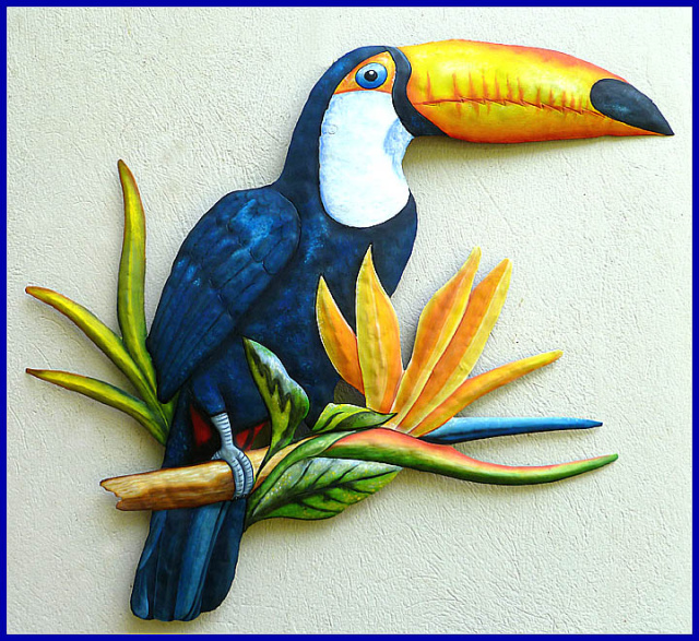 painted metal toucan wall hanging. parrot
