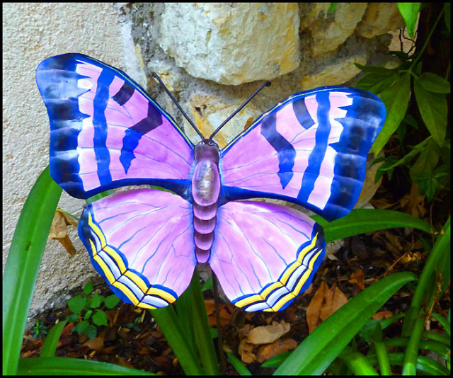 Painted metal butterfly plant stick.